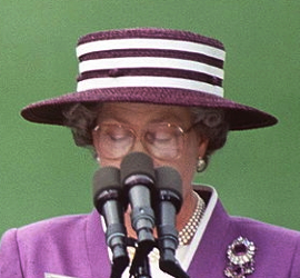 e6fbcacb33506 The purple straw boater with white stripes  talking hat  worn on May 14